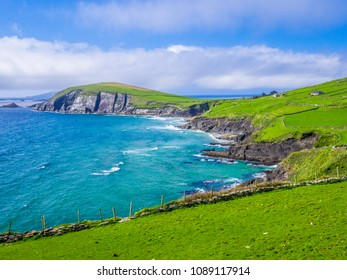 Green hills and blue Ocean water - typical for Ireland west coast