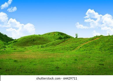 Green hills and clear sky