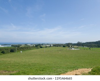 green hills with sea in the horizon