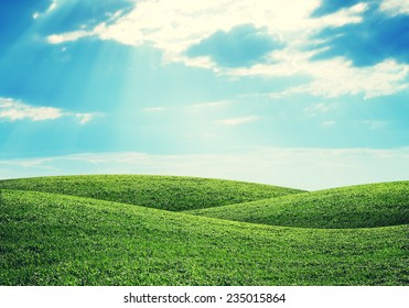 Green hills under bright sky. Nature concept