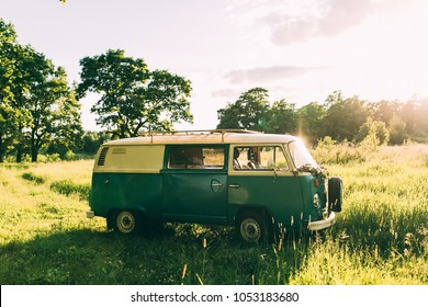 green hippie bus in green forest photographed at sunset