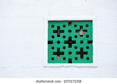 Green hollow bricks on white wall