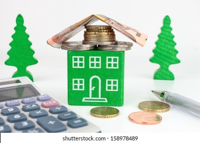 A green home with Euro money for the roof, representing savings to be made with an energy efficient home.