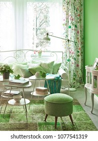 Green home interior with sofa, desk, chair and  decorative part of home accessory