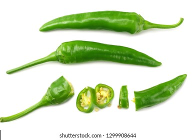 green hot chili peppers with slices isolated on white background top view