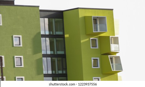 Green house with asymmetric funny balconies