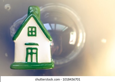 Green house in bubbles with white background. Concepts of real estate market bubble, booming, money, price, home, subprime mortgage crisis.