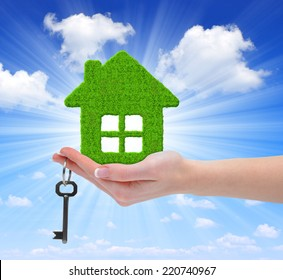 green house with key in hand