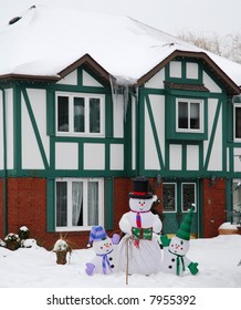 Green House with snowman decoration