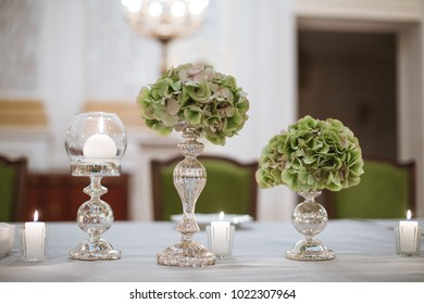 green hydrangeas in silver vases