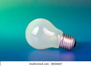 Green idea concept - light bulb on color background