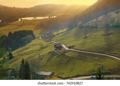 Green idyllic mountain landscape at sunset with warm yellow light in the Alps in Germany