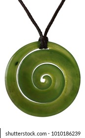 Green jade spiral as a symbol gemstone pendant Koru from New Zealand with white background.