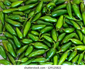 Green Jalapeno chillies as a background