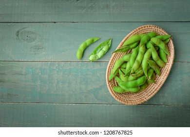 Green Japanese Soybean in wooden bowl on table wood, Fresh steamed edamame sprinkled with sea salt