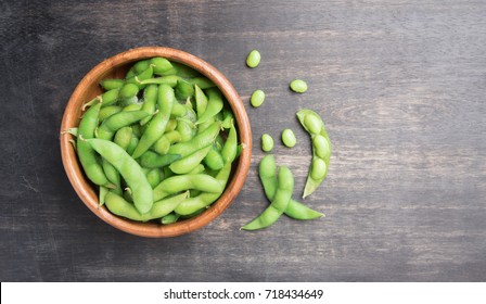 Green Japanese Soybean in wooden bowl on table wood,top view