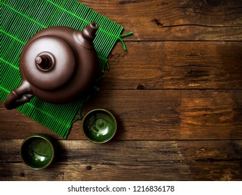 Green japanese tea on wooden table. Top view with copy space