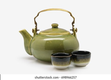 Green Japanese teapot and teacup on white background