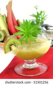 Green jelly with kiwi fruit, rhubarb and sweet woodruff