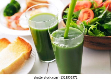 Green juice and breakfast image