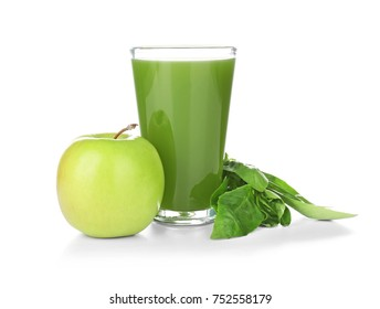 Green juice in glass and ingredients on white background