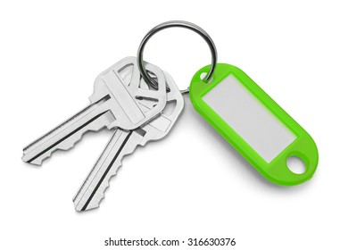 Green Key Chain Tag and Keys Isolated on White Background.