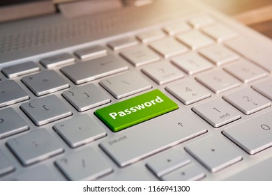 green key with stop palm icon symbol on laptop keyboard. Color button on the gray silver keyboard of modern ultrabook. caption on the button