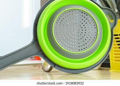 green kitchen colander. Plastic Colander