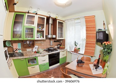 Green Kitchen interior with many utensils and window, fisheye View