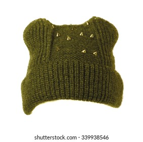 green knitted women's hat  isolated on white background .