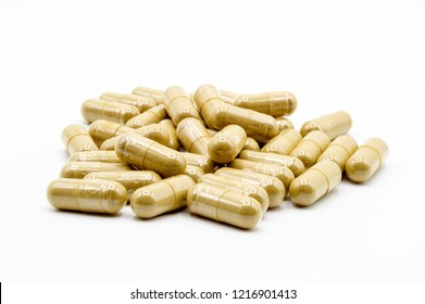 Green Kratom capsules on white background with all pills in focus.