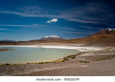 The green Lagoon Licancabur Colcano with snow top mountain scenery of during dessert crossing with a 4x4  in Uyuni Salt Flats in Bolivia.