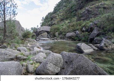 Green lagoon surrounded by rocks and vegetation, in Arado river, Peneda Geres National Park