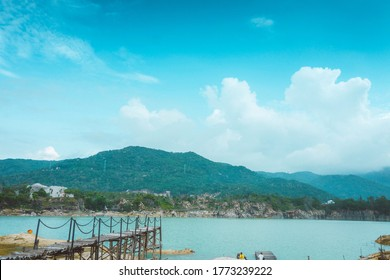 Green Lake (local name is Ho Da Xanh) look like the hydraulic painting between Vung Tau, Vietnam. Vung Tau is the capital of the crude oil extraction center of Vietnam.