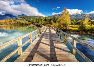 Green Lake Promenade in Whistler, BC. A beautiful Autumn walk along the shore of Green lake and Nicklaus North Golf course looking towards Blackcomb mountain