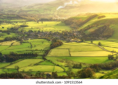 Green landscape of farm fields and village view in Peak District National Park, United Kingdom