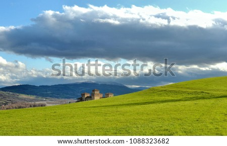 green landscape on hills around Parma and grass field near Torrechiara castle,  Italy