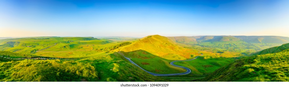 Green landscape panorama of Peak District with Serpentine road