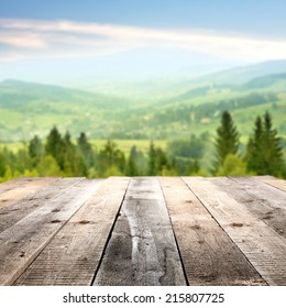green landscape and terrace of wood