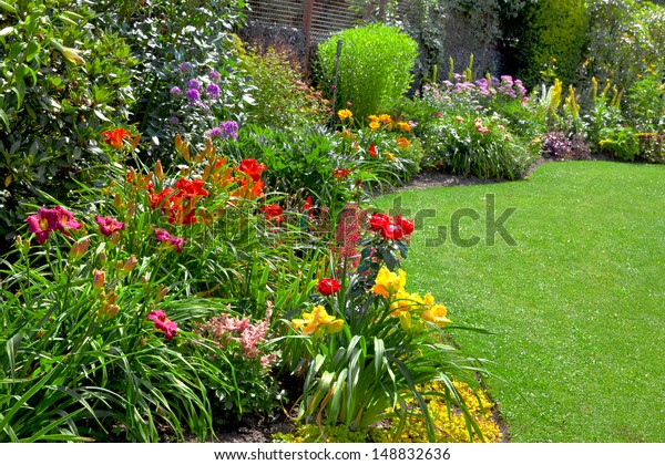 Green lawn in a colorful landscape formal garden. Beautiful Garden.