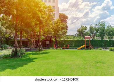 green lawn field backyard playground nature garden outdoor space for children background.