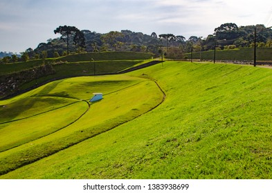 Green lawn on the slope of dam