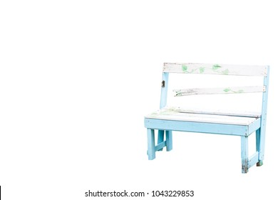green leaf arts painted on the blue and white broken old wooden bench, isolated on white background
