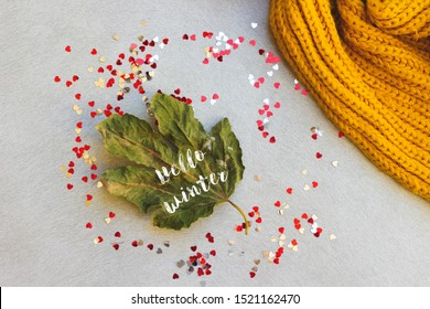green leaf, heart confetti and woolen scarf. hello autumn concept