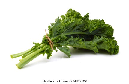 Green leafy kale vegetable isolated on white studio background