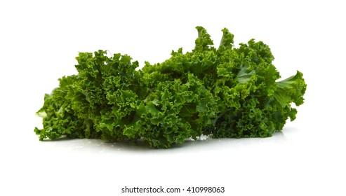 Green leafy kale vegetable isolated on white studio background