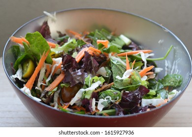a green leafy salad with different colors