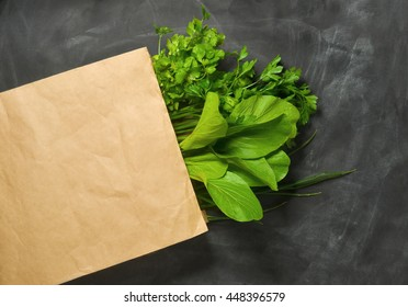 green leafy vegetables in grocery bag