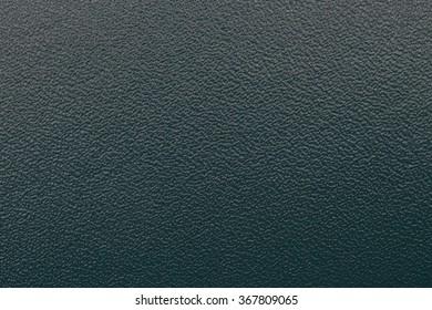 green   leather purse Texture closeup
