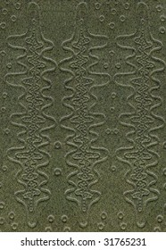 green leathercraft tooled vintage book cover with texture and grain